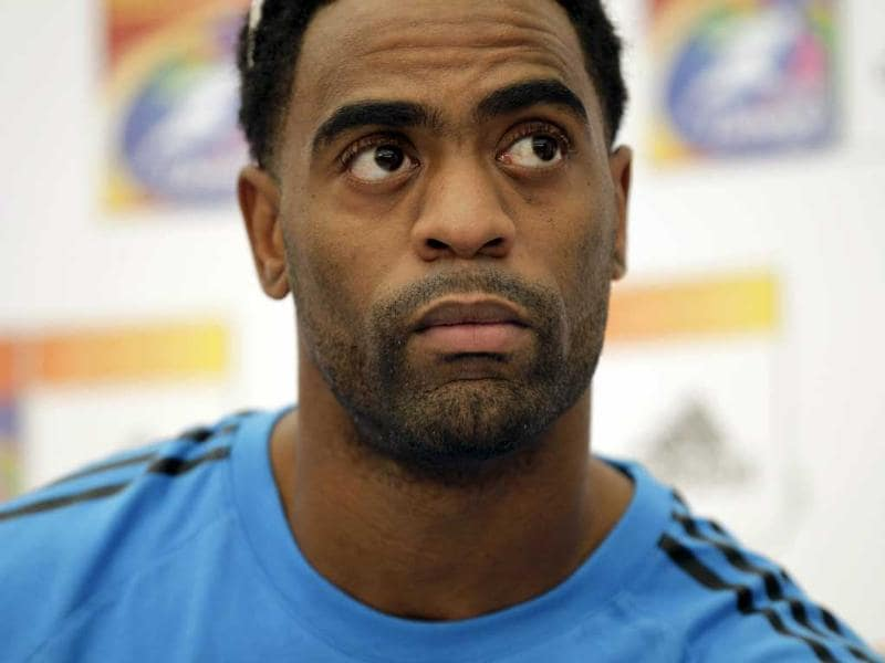 Injured US sprinter Tyson Gay takes part in a news conference for the World Athletics Championships at the stadium in Daegu, South Korea.