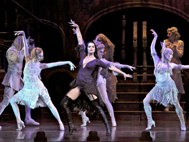 In this theater image released by The Publicity Office, Brooke Shields portrays Morticia Addams, center, in a performance of The Addams Family, in New York. The production will end its run on Dec. 31, 2011.