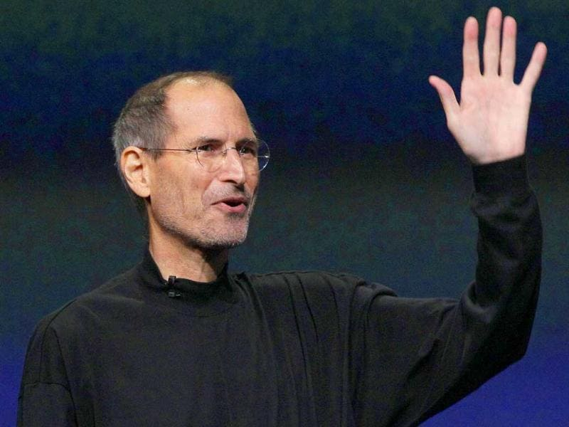 (File photo) Apple Inc. Chairman and CEO Steve Jobs waves to his audience at an Apple event at the Yerba Buena Center for the Arts Theater in San Francisco. Apple Inc. today said Jobs is resigning as CEO, effective immediately.