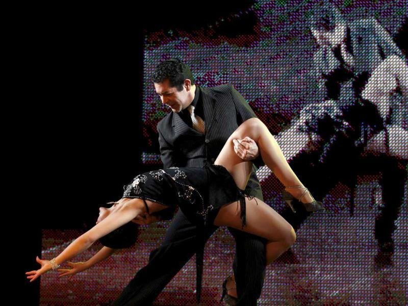 Jose Luis Medina (C) and Natalia Liendo of Argentina perform during the qualifying round stage of Argentina's eighth edition of the Tango Dance World Championship in Buenos Aires.
