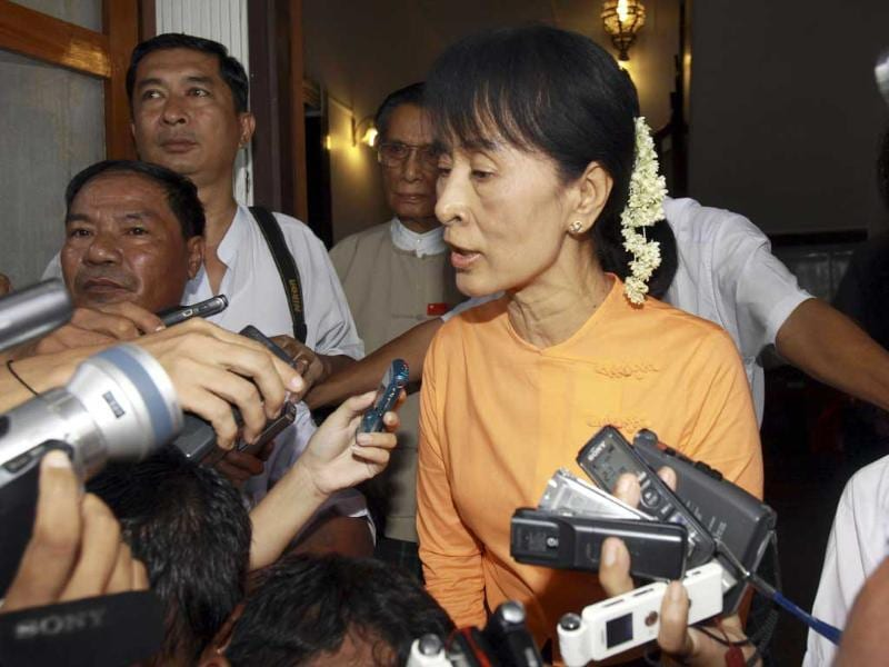 Myanmar's democracy icon Aung San Suu Kyi speaks to journalists after meeting with Tomas Ojea Quintana, UN special envoy on human rights in Myanmar, at her home in Yangon, Myanmar.