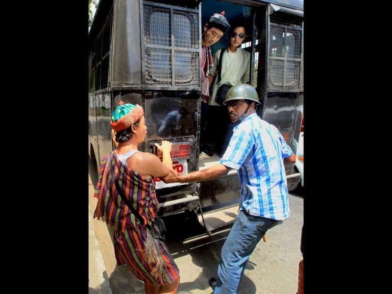 Police detain Lepcha community members during their dharna to press their various demands in Kolkata.