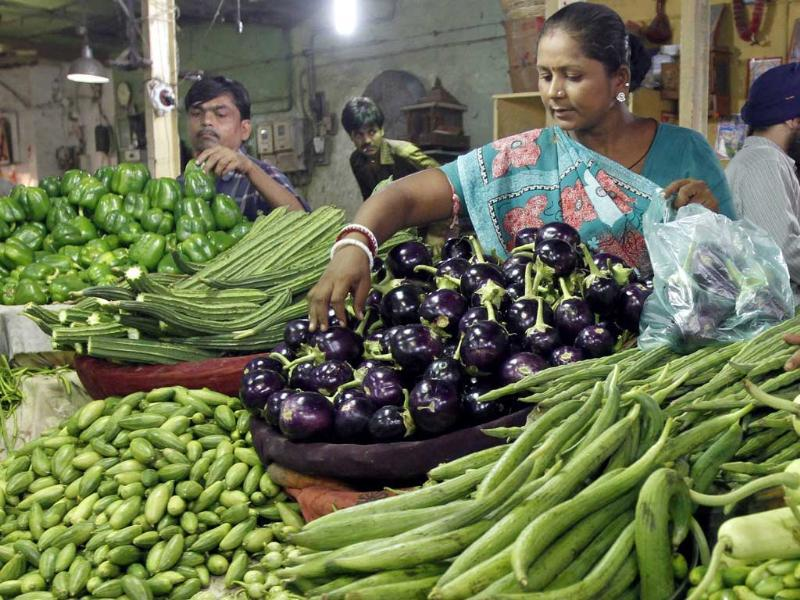 Customers buy vegetables at a market in the Ahmedabad. India's food price index rose 9.80% in the year to August 13, government data on Thursday showed.