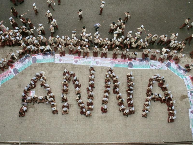 School children form a human chain that reads