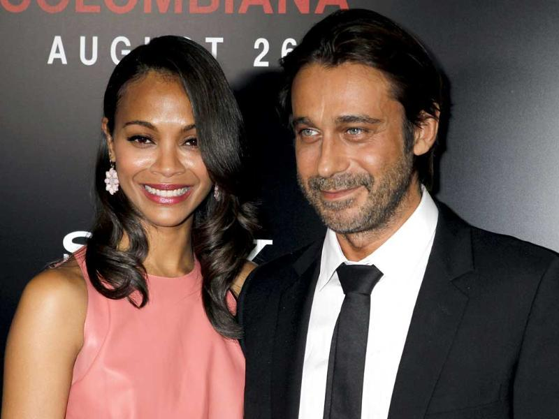Actor Zoe Saldana and Jordi Molla arrive at a special screening of their new film Colombiana in Los Angeles, California. Check out more pics from the screening. (Reuters)