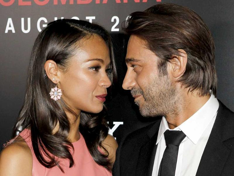 Actor Zoe Saldana and Spanish actor Jordi Molla arrive at a special screening of their new film Colombiana. (Reuters)