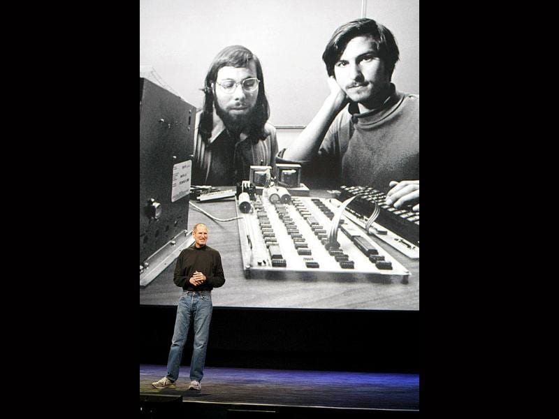 In this file photo taken Jan. 27, 2010 file photo, Apple CEO Steve Jobs stands in front of a photo of himself, right, and Steve Wozniak, left, during an Apple event in San Francisco.