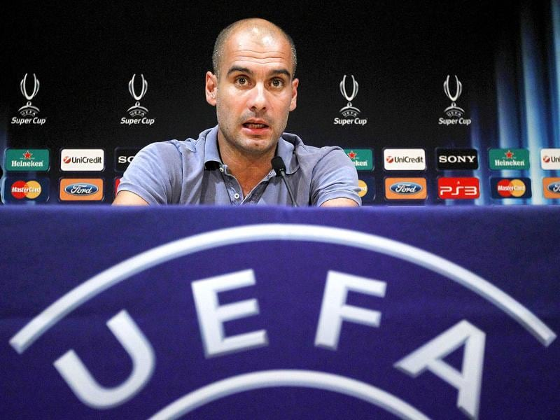 Barcelona's coach Josep Guardiola attends a press conference in Monaco on the eve of the UEFA Super Cup football match between Internazionale Barcelona vs. Porto.