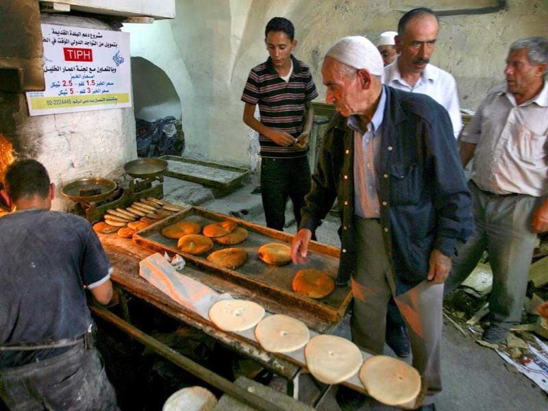 Palestinians shop in the Old City of Hebron during Islam's holy month of Ramadan.