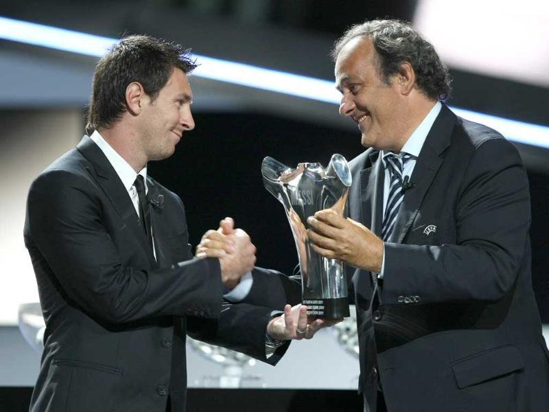 UEFA President French Michel Platini,gives the trophy of Best player in Europe to Lionel Messi, FC Barcelona in Monaco.