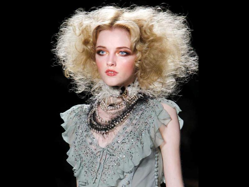 Curls: This is an evergreen hairstyle and can probably never go out of fashion. You needn't look scary like that though.