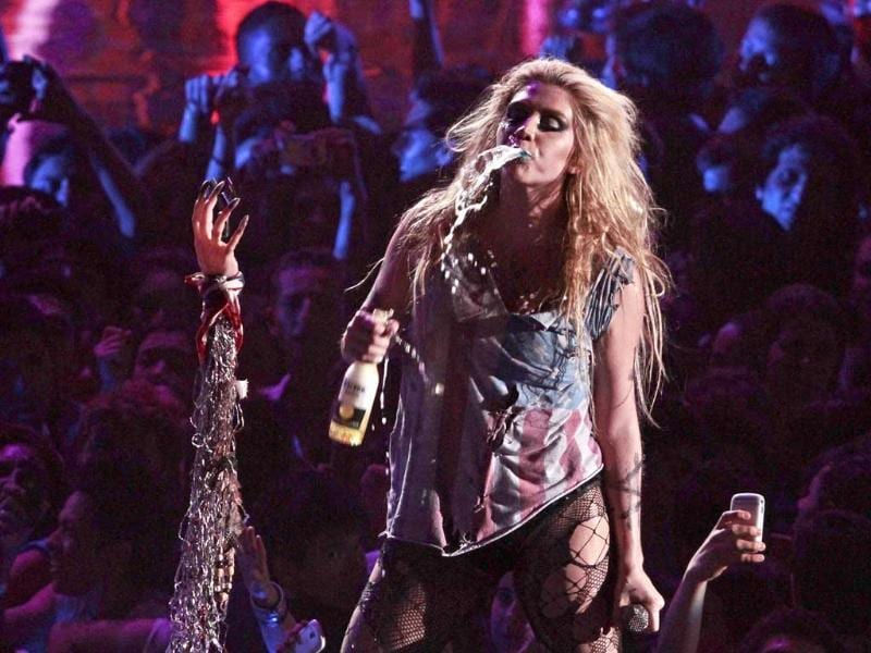 Singer Ke$ha spits out beer while performing at a taping of the 2011 MTV World Stage Mexico. (AP)