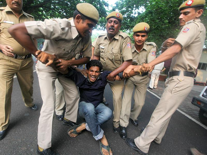 Anna Hazare supporters being detained while demonstrating at the residence of Congress MP Rahul Gandhi in New Delhi.