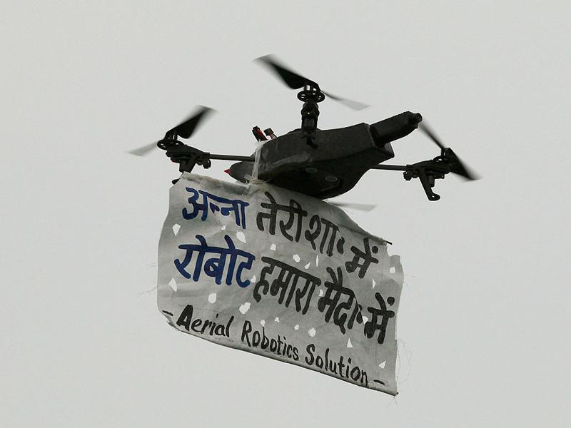 A Robot Helicopter carrying a Anna Hazare's message during the 11th day of Anna Hazare fast against corruption at Ramlila Ground.