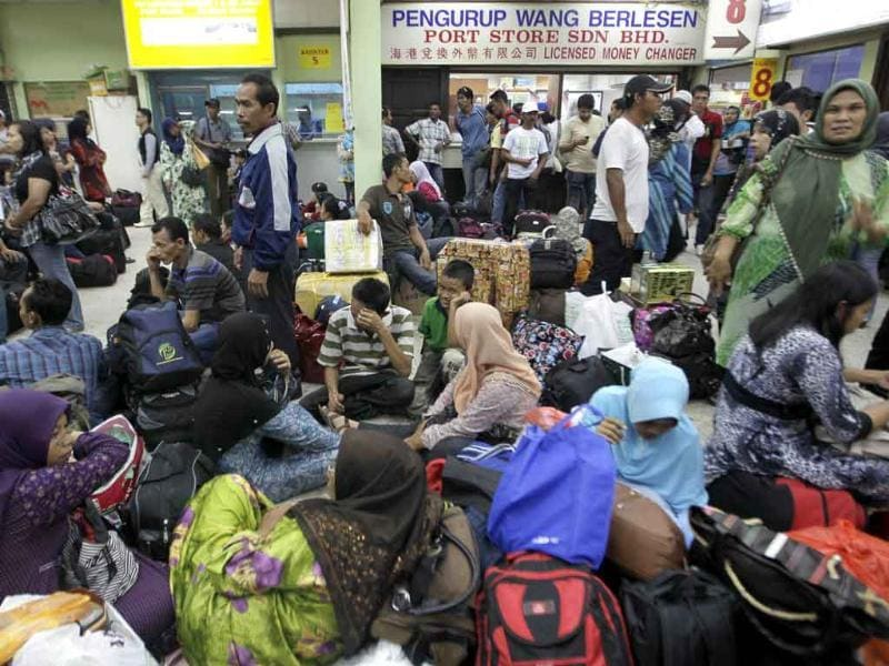 Indonesians working in Malaysia wait to take a ferry to Dumai in Indonesia, ahead of Eid al-Fitr in Port Klang outside Kuala Lumpur.