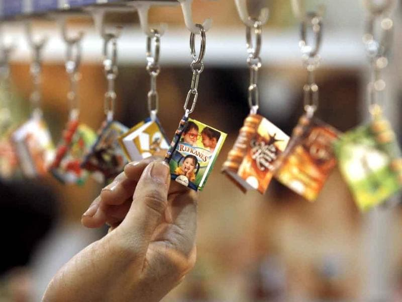A Salvadoran touches a miniature book at the XV International Book Fair of Central America, in San Salvador.