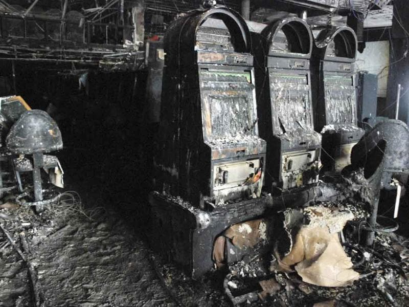 Burnt slot machines inside the Casino Royale after it was torched by armed men in Monterrey. Mexico's President Felipe Calderon declared three days of mourning and demanded a crackdown on drugs in the United States after armed men torched a casino in northern Mexico, killing at least 52 people.