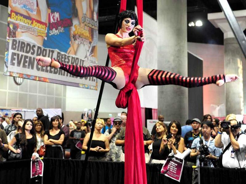 A crowd gathers to watch a burlesque performance on the openinig day of the 2011 Exxxotica Expo in Los Angeles, California.