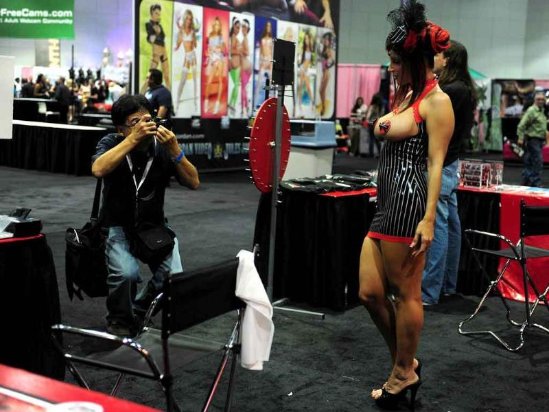 Adult entertainment industry star Rubberdoll poses for pictures on opening day at the 2011 Exxxotica Expo in Los Angeles, California.