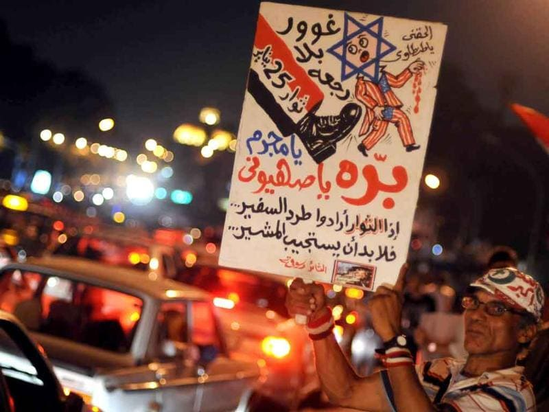 Egyptian protesters gather outside the Israeli embassy in Cairo, demanding the ambassador's expulsion, after five Egyptian policemen were killed along the border with Israel last week.