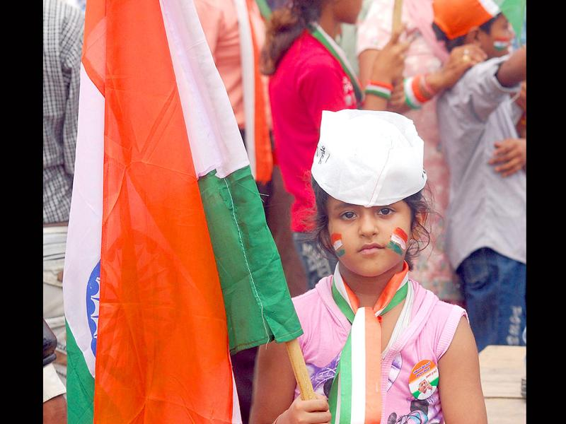 A young supporter of civil society leader Anna Hazare holding a tri-colour on the 12th day of his fast against corruption at Ramlila Ground in New Delhi.