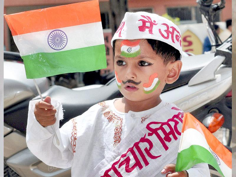 A young supporter of civil society leader Anna Hazare holding tri-colour on the 12th day of his fast against corruption at Ramlila Ground in New Delhi on Saturday.