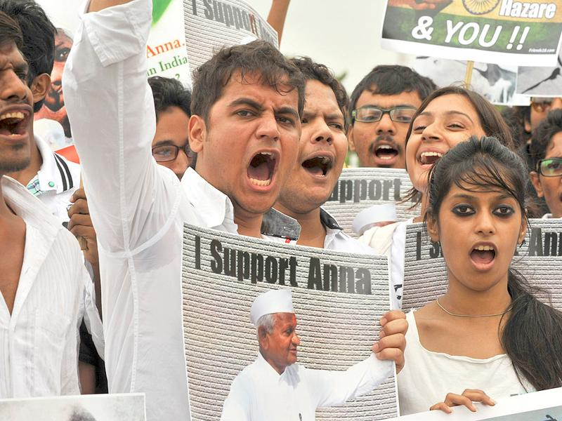 Supporters of anti-corruption activist Anna Hazare shout slogans during a rally in Hyderabad.