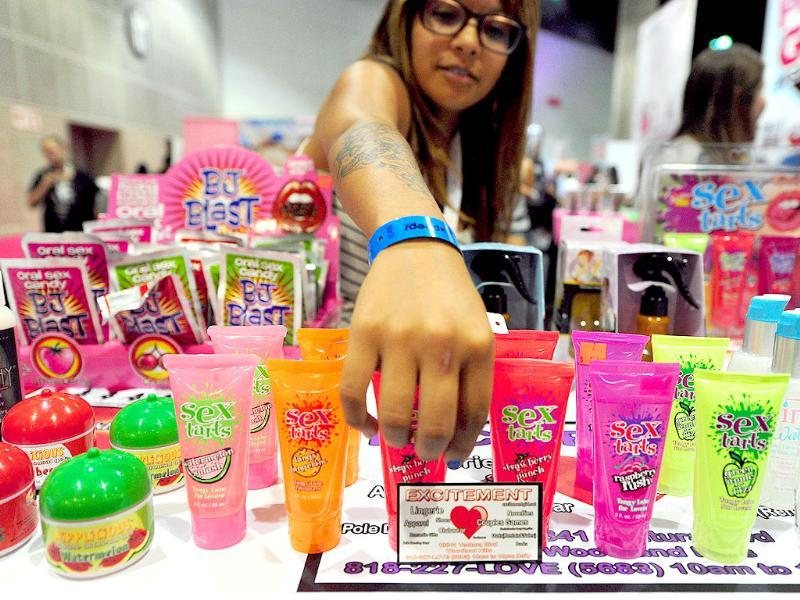 A vendor prepares her display of products on opening day of the 2011 Exxxotica Expo in Los Angeles, California.