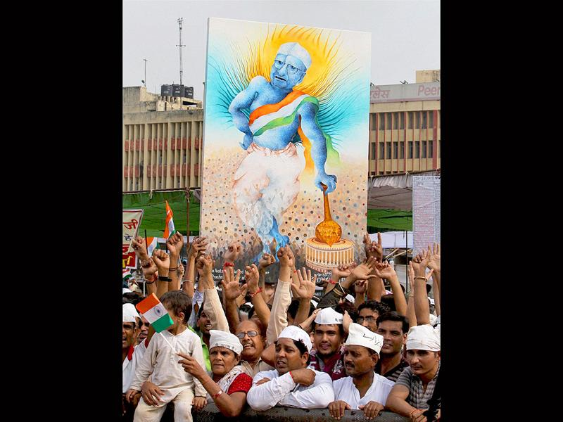 Supporters of Anna Hazare during their protest against corruption at Ramlila Ground in New Delhi on Saturday.