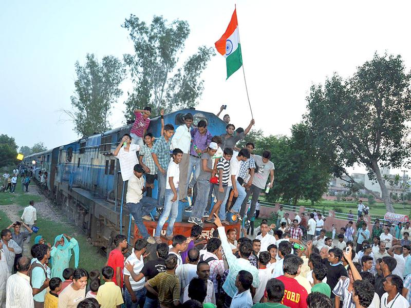 Hundreds of supporters of Anna Hazare stopped a train bound for Panipat at Rohtak on Saturday.