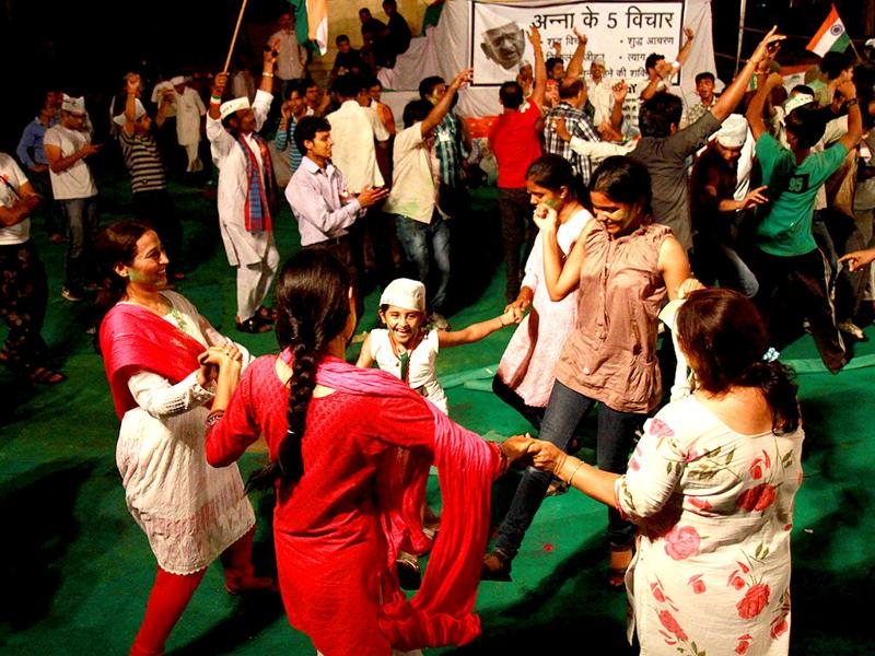Supporters of Anna Hazare celebrate after government agreed for Lokpal Bill in New Delhi on Saturday.