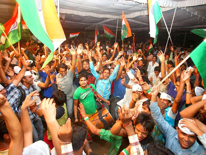 Supporters of Anna Hazare celebrate after government agreed for Lokpal Bill in New Delhi.