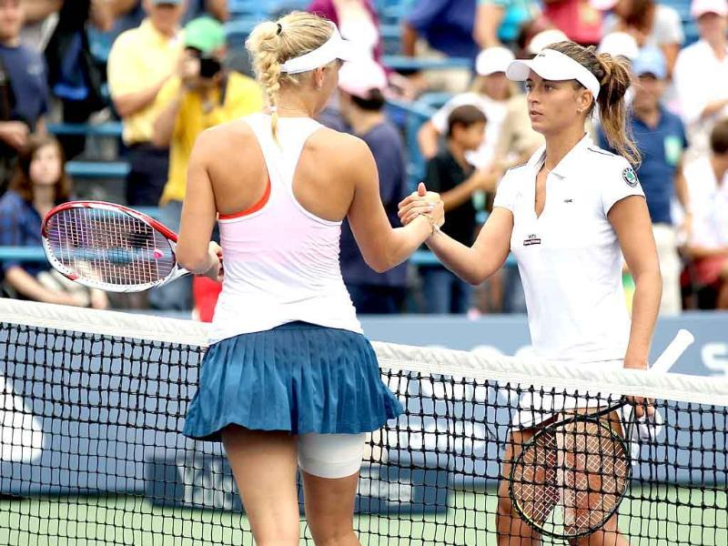 Caroline Wozniacki of Denmark is congratulated by Petra Cetkovska of the Czech Republic after their match during the final of the New Haven Open at Yale presented by First Niagara at the Connecticut Tennis Center in New Haven, Connecticut.