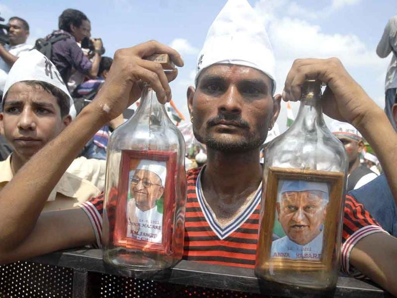 Physically disabled Mohammad Jahangir from Jaipur, who framed Anna Hazare's photographs in bottles, displays them during the celebrations after veteran social activist Anna Hazare broke his fast.