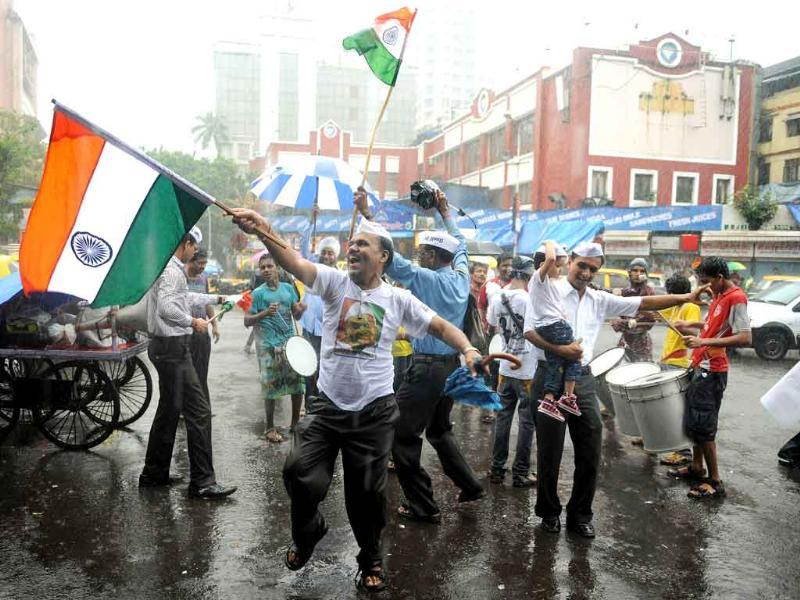 People celebrate in support of social activist Anna Hazare in Mumbai.