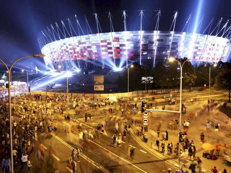 An overall view of the National Stadium as its facade is illuminated for the first time, in Warsaw, Poland.