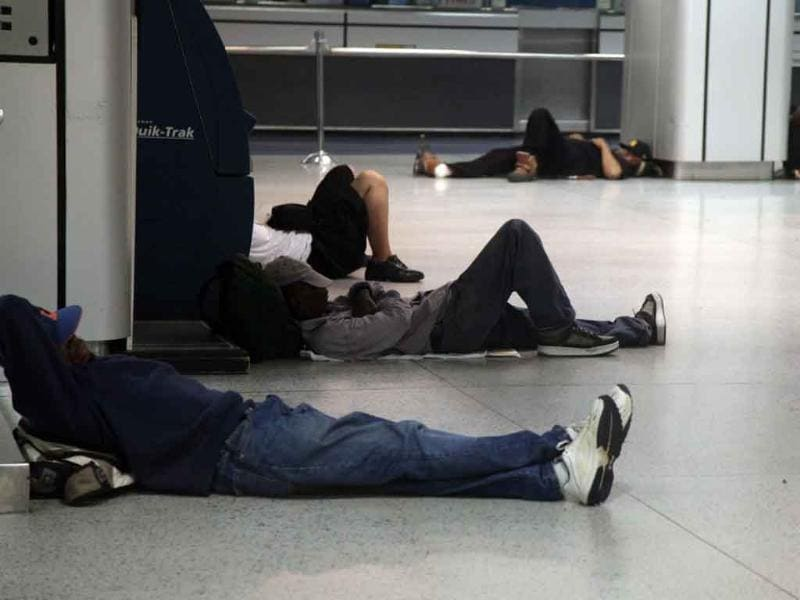 People sleep at Penn Station in New York, as Hurricane Irene approaches the region.