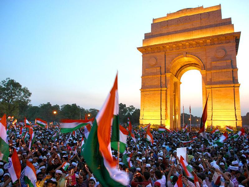 Supporters of Anna Hazare celebrating at India Gate as the government agrees upon the demands of Anna Hazare on Lokpal Bill in New Delhi.