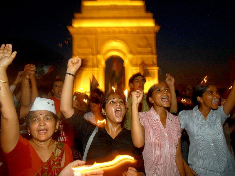 Supporters of Anna Hazare celebrating as government agreed upon the demands of Anna Hazare on Lokpal Bill at India Gate in New Delhi.