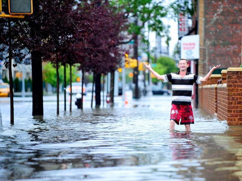 A resident walks through floodwater on Coney Island after Hurricane Irene hit, in New York.