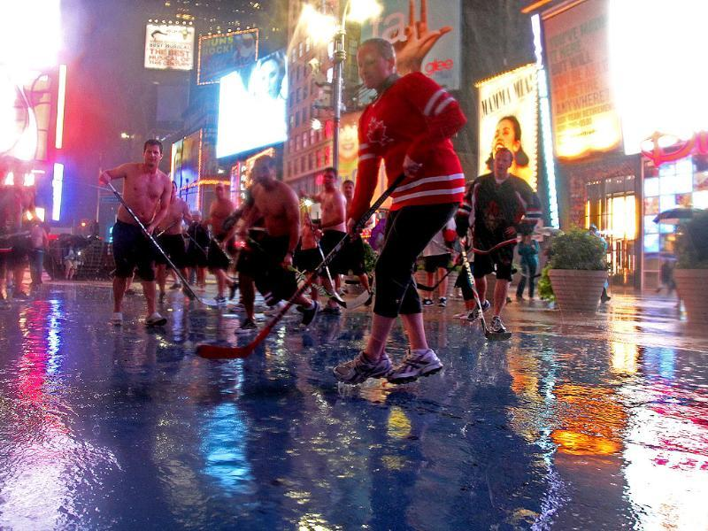 Hockey players from Vancouver, British Columbia, play an impromptu hockey game at Times Square in New York.