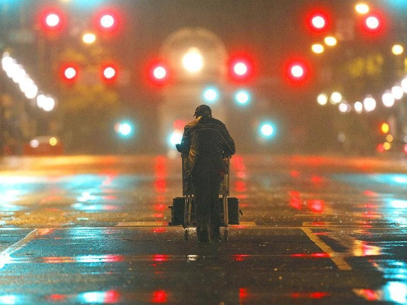 Lenard Sanders, a homeless man, pushes his cart toward a subway station to seek shelter as Hurricane Irene makes its way along the Eastern Seaboard.