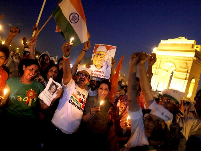 Supporters of social activist Anna Hazare celebrate at India Gate in New Delhi.