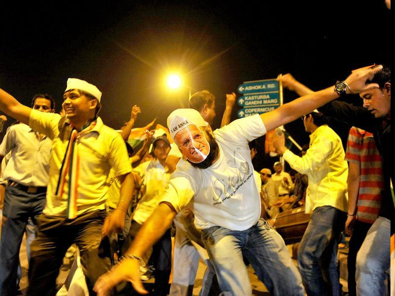 Supporters of anti-corruption activist Anna Hazare celebrate near the India Gate monument in New Delhi.