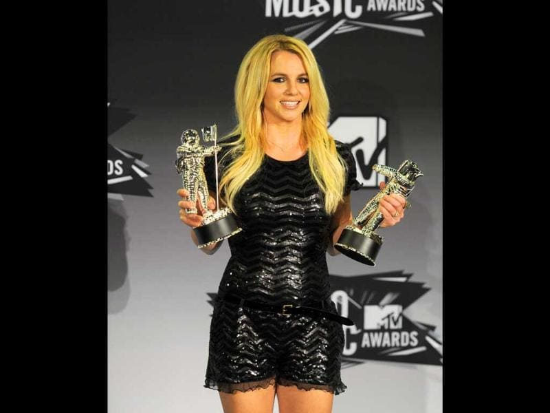 Britney Spears poses with the video vanguard award backstage at the MTV Video Music Awards in Los Angeles.