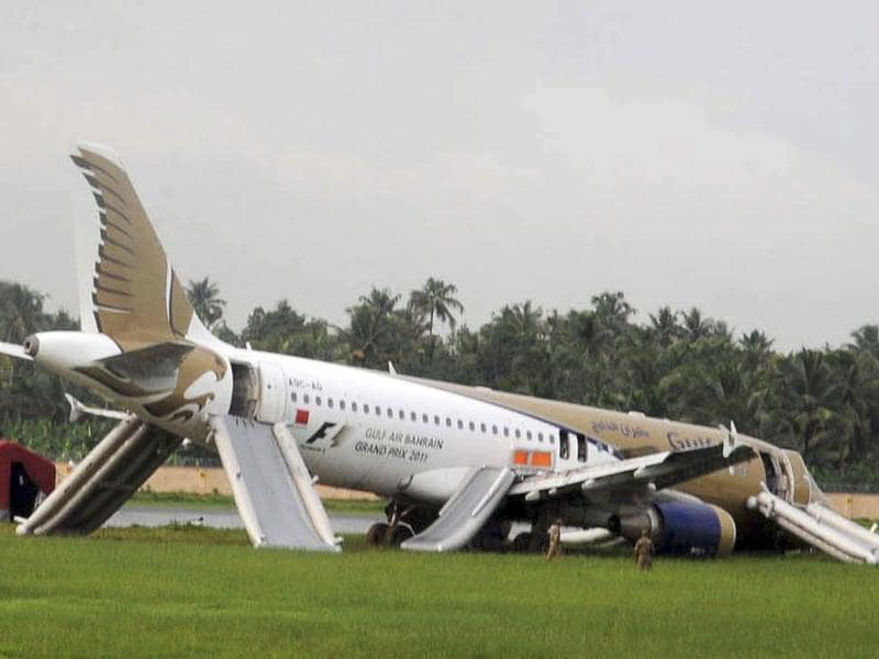 A Gulf Air passenger planes lies on the ground after it skidded off the runway at Kochi International Airport in Kochi.