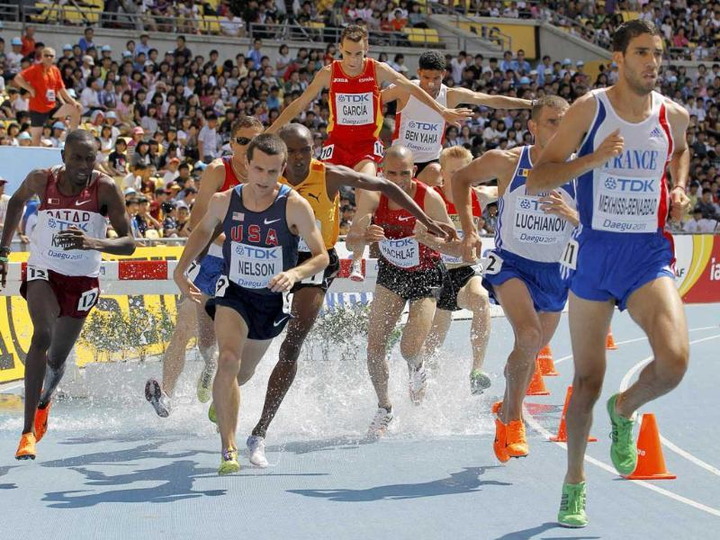 Mahiedine Mekhissi-Benabbad of France (R) leads a group of competitors out of the water jump during their men's 3,000 metres steeplechase heat at the IAAF World Championships in Daegu.