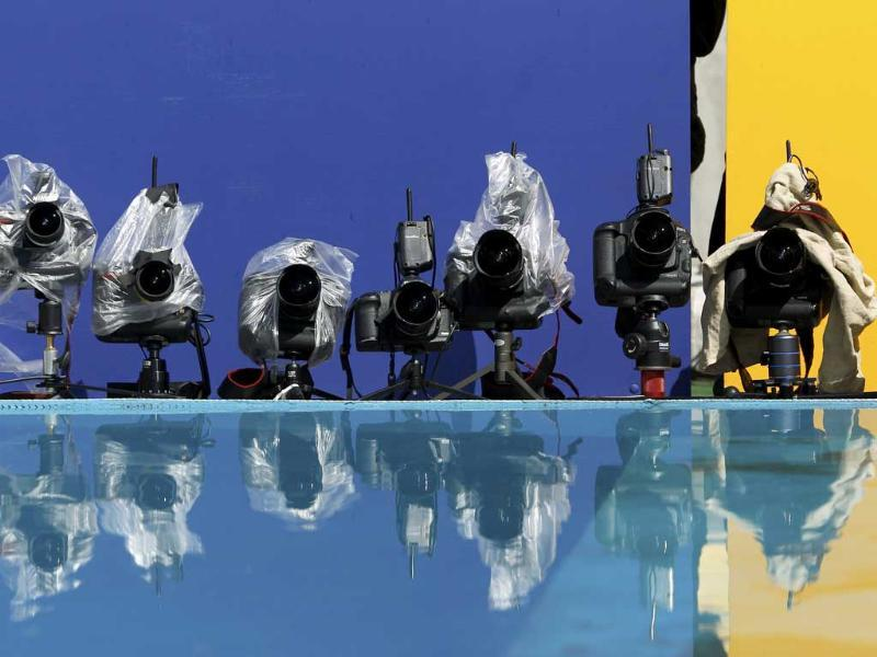 Remote cameras are reflected in the water jump of the steeplechase event at the IAAF World Championships in Daegu.