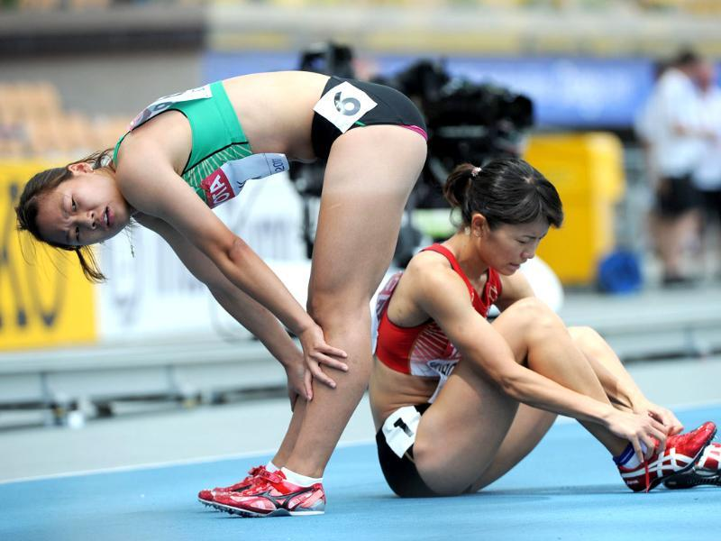 Japan's Satomi Kubokuroa and South Korea's Son Kyeong-Mi catch their breath following the women's 400 metres hurdles heats at the International Association of Athletics Federations World Championships in Daegu.