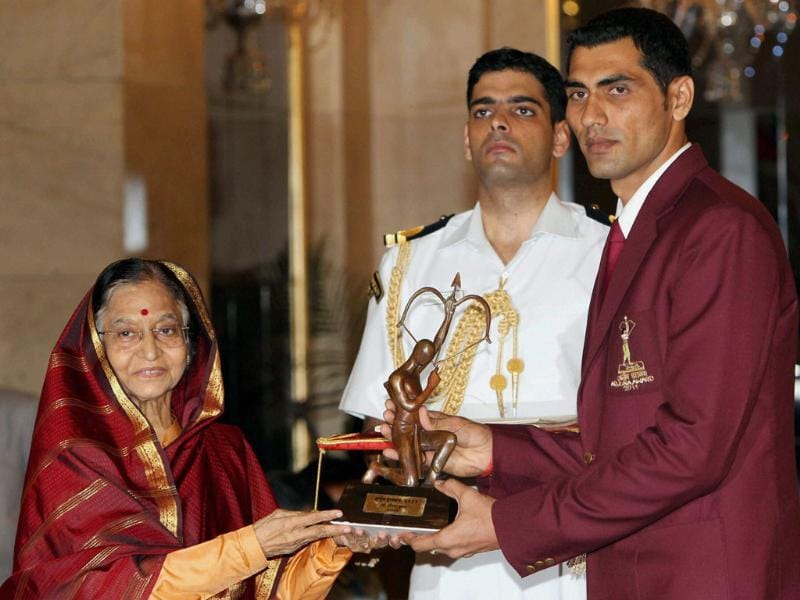 President Pratibha Patil presents Arjuna Award to volleyball player Sanjay Kumar at Sports and Adventure Awards 2011 function at the Rastrapati Bhavan in New Delhi.